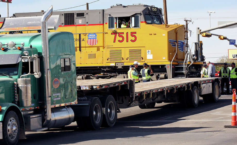 Officials take part in a National Transportation Safety Board sight distance test, Tuesday Nov. 20, 2012 in Midland, Tx., at the intersection of the Union Pacific railroad tracks on South Garfield Street, near West Industrial Avenue where a Union Pacific train struck a parade float at 4:36 p.m. Thursday Nov. 15, 2012, killing four veterans injured in combat. Photo: Edward A. Ornelas, San Antonio Express-News / © 2012 San Antonio Express-News