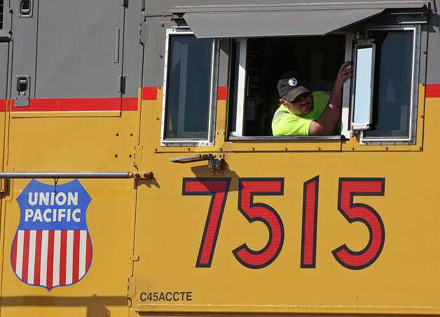 A Union Pacific train crew member takes part in a National Transportation Safety Board site distance test, Tuesday Nov. 20, 2012 in Midland, Tx., at the intersection of the Union Pacific railroad tracks on South Garfield Street, near West Industrial Avenue where a Union Pacific train struck a parade float at 4:36 p.m. Thursday Nov. 15, 2012, killing four veterans injured in combat. Photo: Edward A. Ornelas, San Antonio Express-News / © 2012 San Antonio Express-News