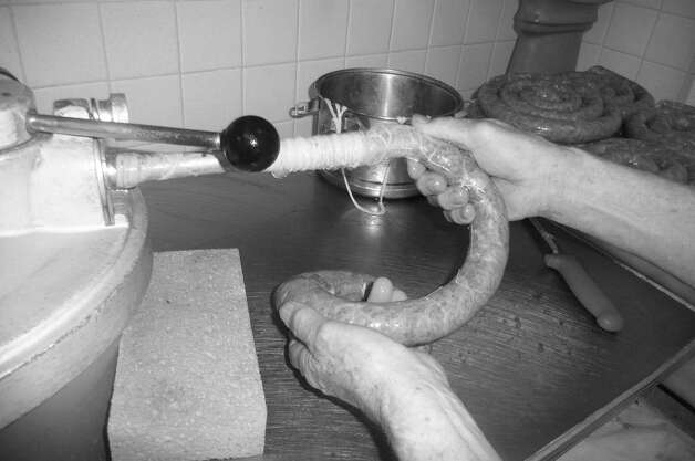 An up-close look at sausage being fed into a casing. Photo: Contributed Photo