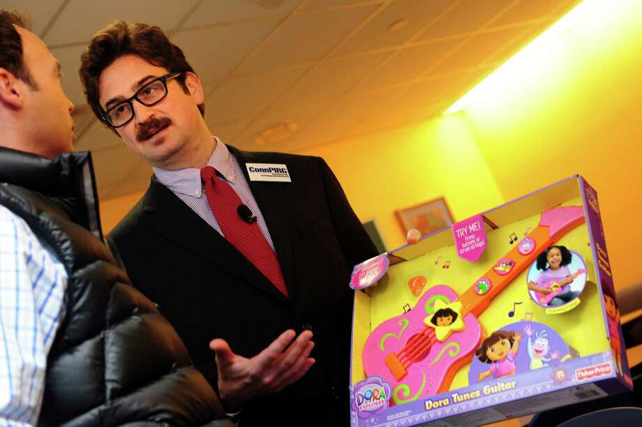 "Abe Scarr, ConnPIRG director, discusses the group's 27th ""Trouble in Toyland"" report Tuesday, Nov. 20, 2012 at Connecticut Children's Medical Center in Hartford, Conn.  The Fisher-Price Dora the Explorer Dora Tunes Guitar made the list of unsafe toys because of its excessive volume. Photo: Autumn Driscoll / Connecticut Post"
