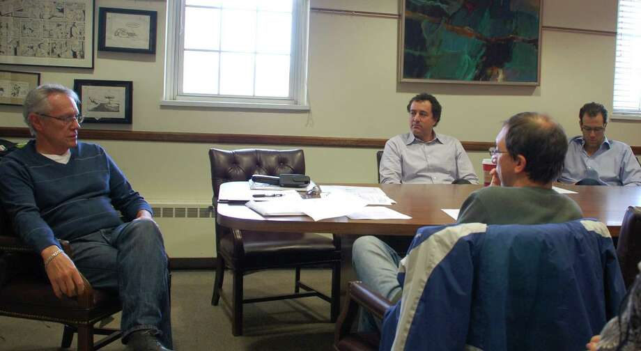 Plans for the Bedford Square development and the problem of downtown flooding dominated Tuesday's meeting of the Downtown 2020 Committee, led by Louis Gagliano, left, the committee chairman.  Westport CT 11/20/12 Photo: Jarret Liotta / Westport News contributed