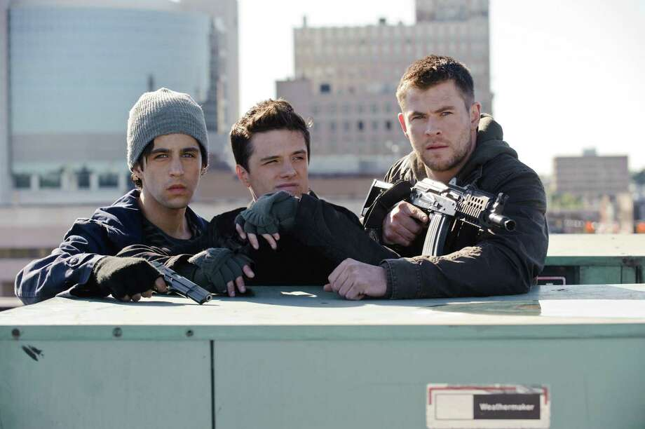 "Josh Peck, from left,  Josh Hutcherson and Chris Hemsworth star in ""Red Dawn."" Photo: Ron Phillips, HO / MCT"