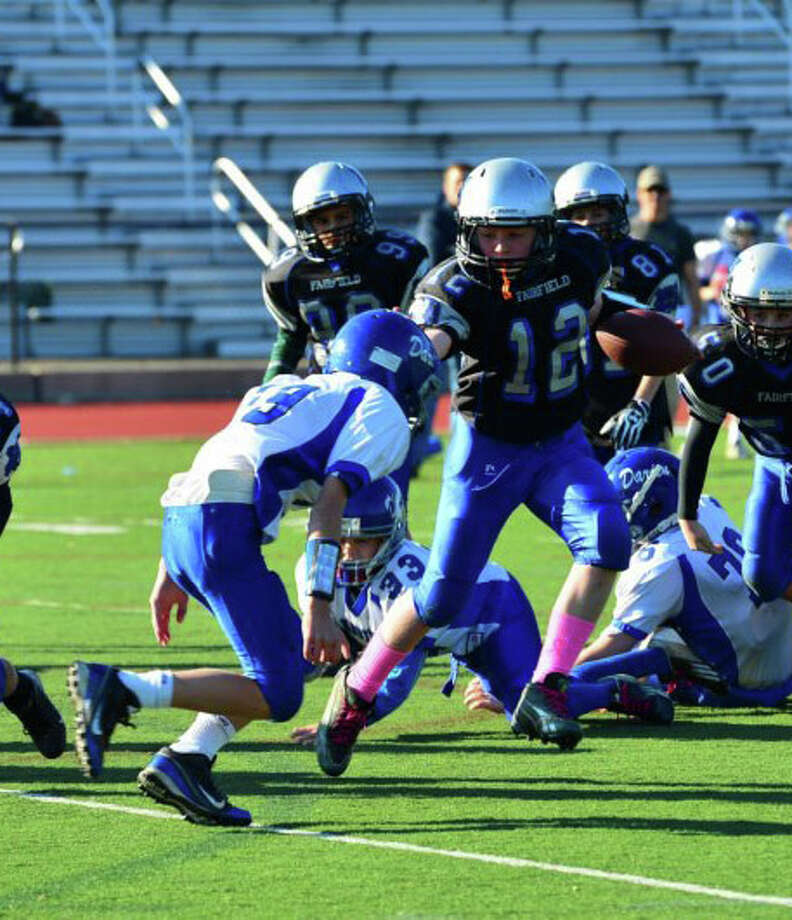 Fairfield Wildcats' sixth-grader David Summers scrambles for a first down. Photo: Contributed Photo