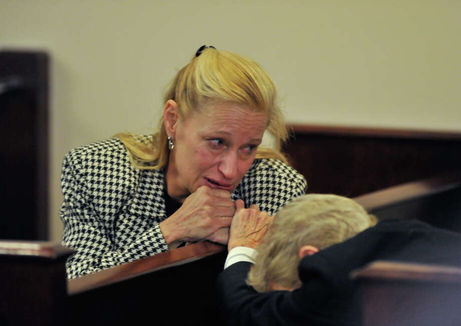 Michelle Lorenz Valicek (left) and her mother, Myra Lorenz, react to Valicek being given 10 year probation after a no-contest plea of embezzlement. Photo: Robin Jerstad/For The Express-Ne