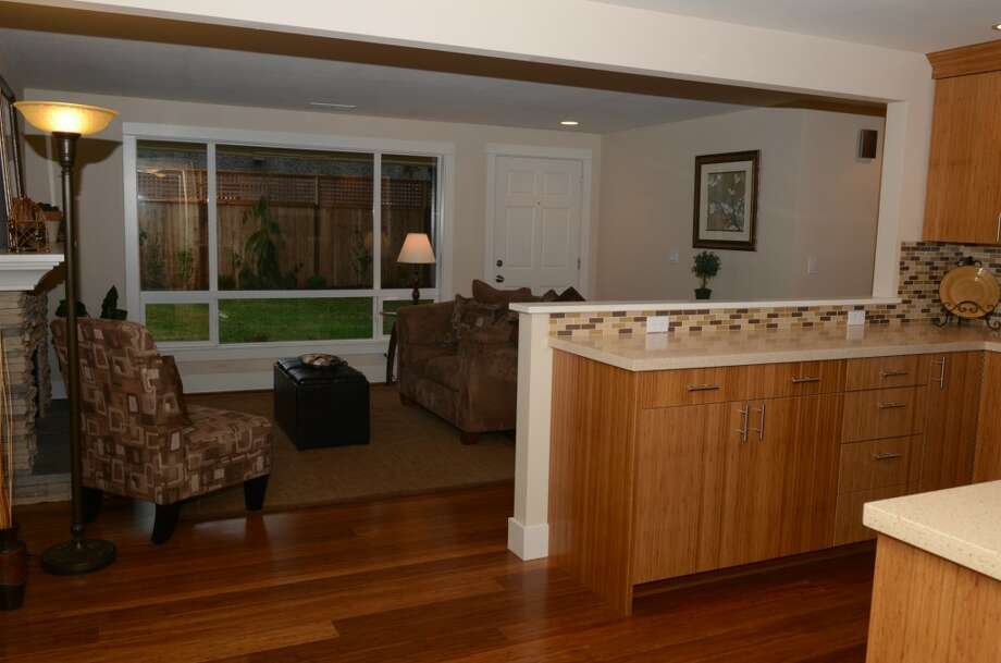 Kitchen and living room of 14326 17th Ave. N.E. The 1,424-square-foot home, built in 1954, has three bedrooms, one bathroom, a family room, bamboo flooring and cabinets, a mud/laundry room and a back deck on a 6,315-square-foot lot. It's listed for $334,950. Photo: Courtesy Rose Johnson/Windermere Real Estate
