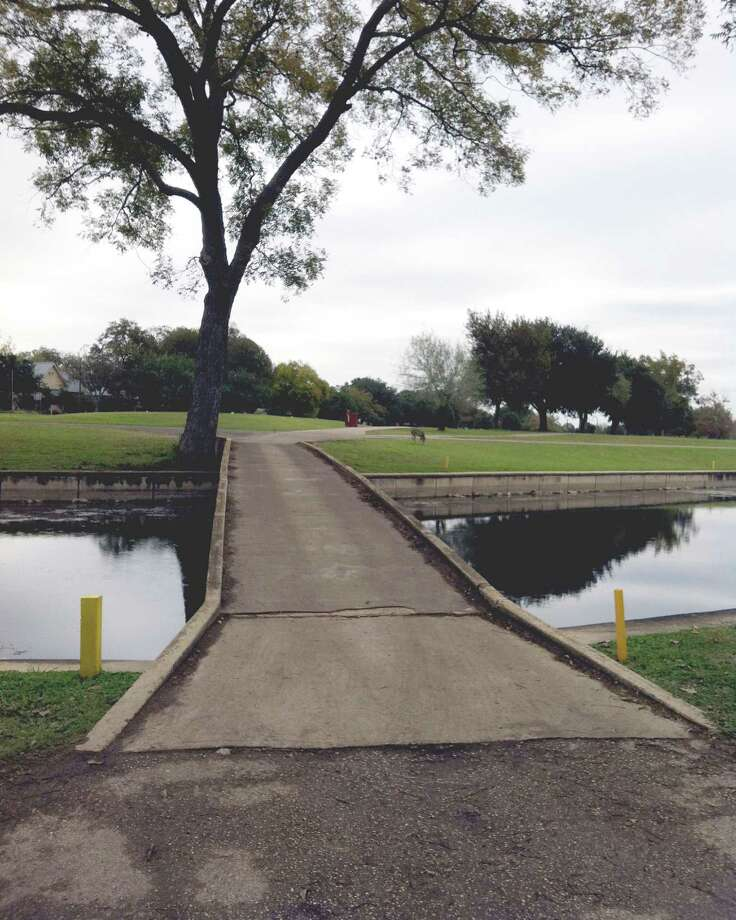 A narrow bridge provides access from the No. 4 fairway to the green at Landa Park Golf Course in New Braunfels.