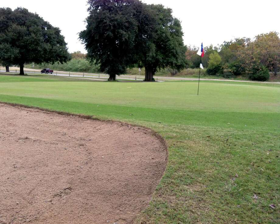 Trouble lurks on the edge of the No. 6 green at Landa Park Golf Course in New Braunfels.