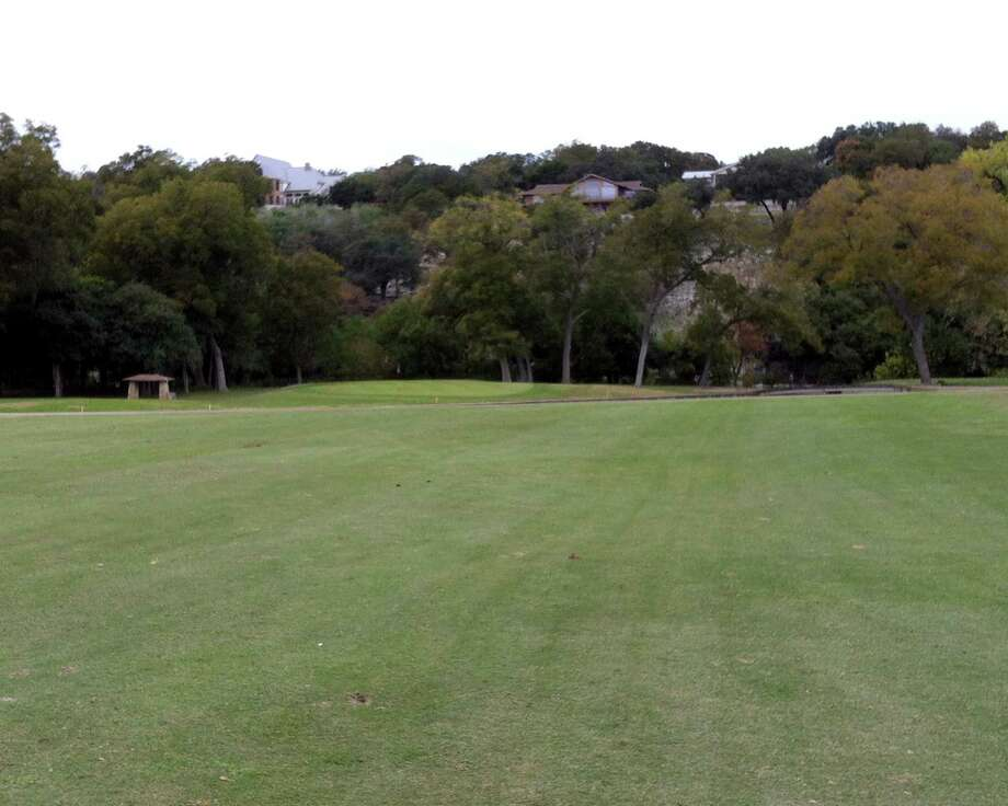 Houses on the cliffs above the Comal River overlook the No. 4 green at Landa Park Golf Course in New Braunfels.