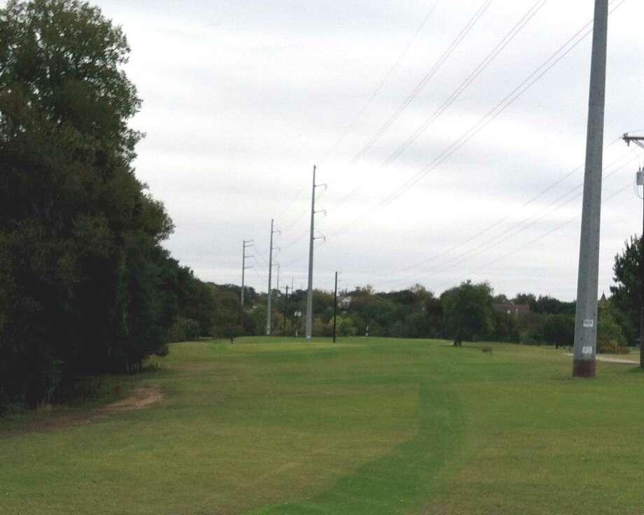 With trees crowding in on the left and power lines and poles on the right, No. 7 at Landa Park Golf Course in New Braunfels calls for accuracy from the tee.