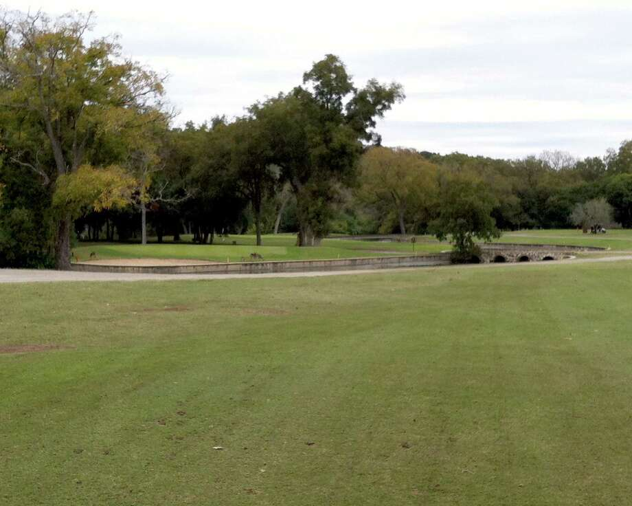 The approaches to the No. 2 and No. 4 greens at Landa Park Golf Course in New Braunfels are protected by a branch of the Comal River.