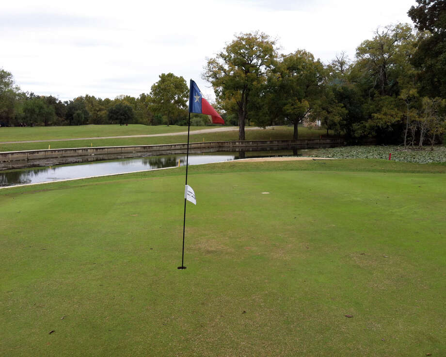 Golfers must clear a branch of the Comal River to land on the No. 2 green at Landa Park Golf Course in New Braunfels.