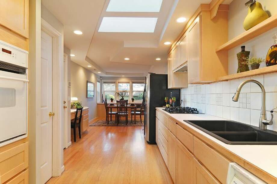 Kitchen of 14050 22nd Ave. N.E. The 2,230-square-foot house was built in 1944, but has an addition. It's three bedrooms and two bathrooms -- including a master suite with a five-piece bathroom -- skylights, a patio and a two-car garage on a 7,085-square-foot lot. It's listed for $325,000, although a sale is pending. Photo: Courtesy Beth Bylund/Windermere Real Estate