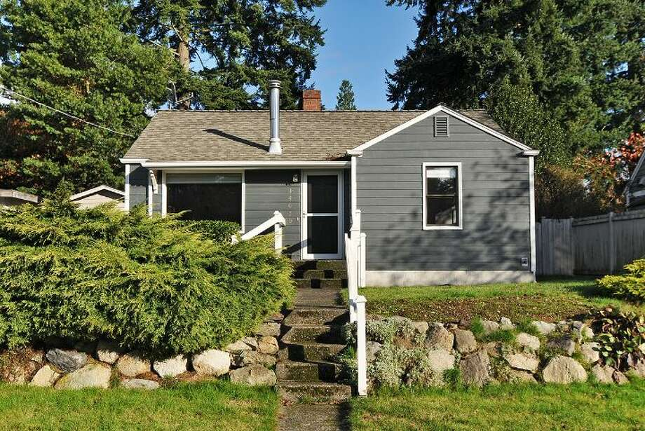 Our final home is 14050 22nd Ave. N.E. The 2,230-square-foot house was built in 1944, but has an addition. It's three bedrooms and two bathrooms -- including a master suite with a five-piece bathroom -- skylights, a patio and a two-car garage on a 7,085-square-foot lot. It's listed for $325,000, although a sale is pending. Photo: Courtesy Beth Bylund/Windermere Real Estate
