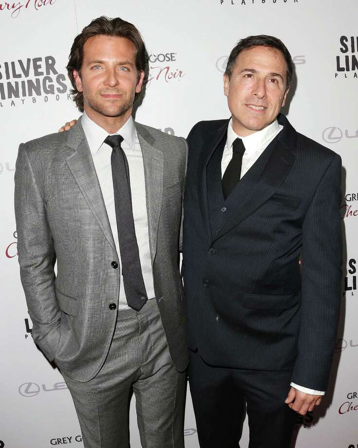 "Bradley Cooper, left, stars in ""Silver Linings Playbook."" Writer David O. Russell (right) directed the movie. Photo: Getty Images / 2012 Getty Images"