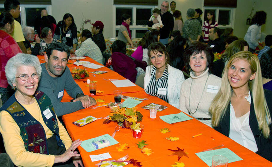 Smiling faces abounded as a full house gathered Nov. 13, 2012 at St. John's Episcopal Church in New Milford for  Literacy Volunteers on the Green's annual American Thanksgiving dinner celebrating tutors and students. Among those on hand for the occasion were, from left to right, Ann Vallombroso, a LVG citizenship tutor; students Ivaldo Barroso and Hildelma Barroso, LVG tutor Kathleen Bertram and Lanny Barroso.   Courtesy of Henry Beary Photo: Contributed Photo