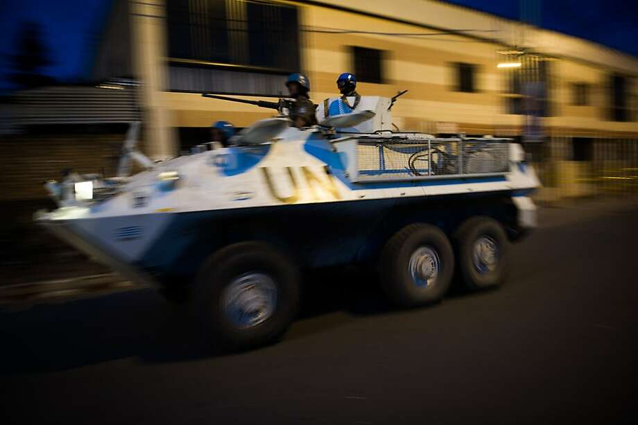 TOPSHOTS A United Nations armoured personnel carrier patrols through the city of Goma following the sound of shell fire and gunshots on November 19, 2012. Rebels and government troops in Democratic Republic of the Congo (DRC) resumed fighting on the outskirts of the key city of Goma, witnesses said. Weapons fire occurred in the neighbourhoods of Munigi and Mudga, to the north and northwest of the city, causing Goma residents to flee south or toward the Rwanda border. AFP PHOTO/PHIL MOOREPHIL MOORE/AFP/Getty Images Photo: Phil Moore, AFP/Getty Images