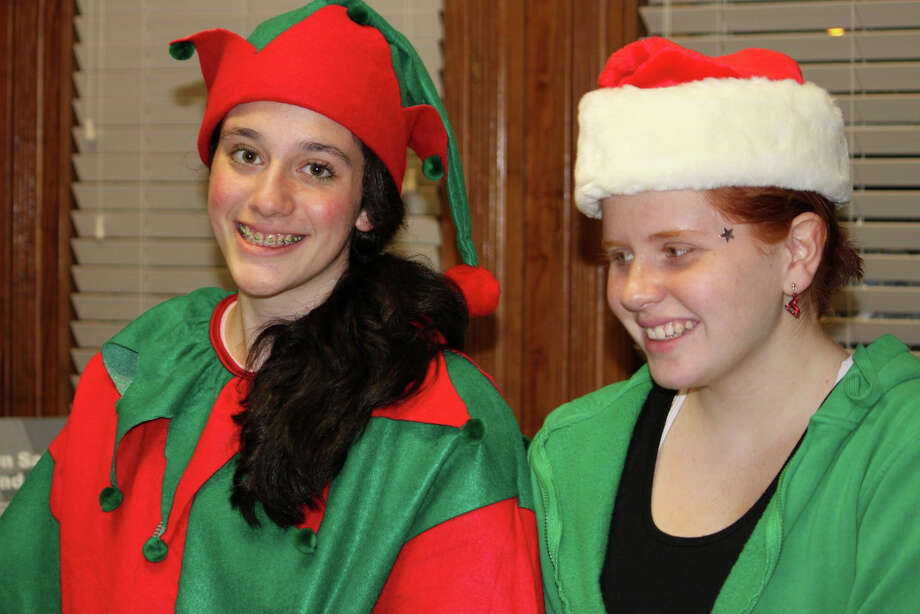 "Elves will be on hand to welcome Santa to Ivoryton's ""Illuminations"" on Saturday, Dec. 1. Photo: Contributed Photo"
