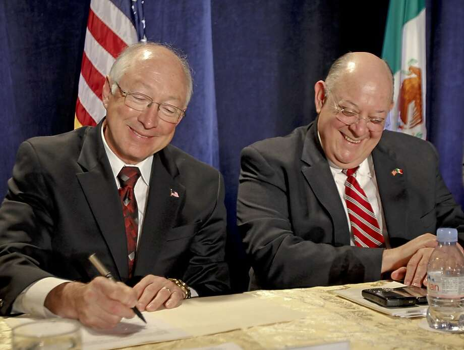 U.S. Interior Secretary Ken Salazar (left) signs the new agreement with Mexican water Commissioner Roberto Salmon. The accord is a major amendment to a 1944 treaty. Photo: Lenny Ignelzi, Associated Press