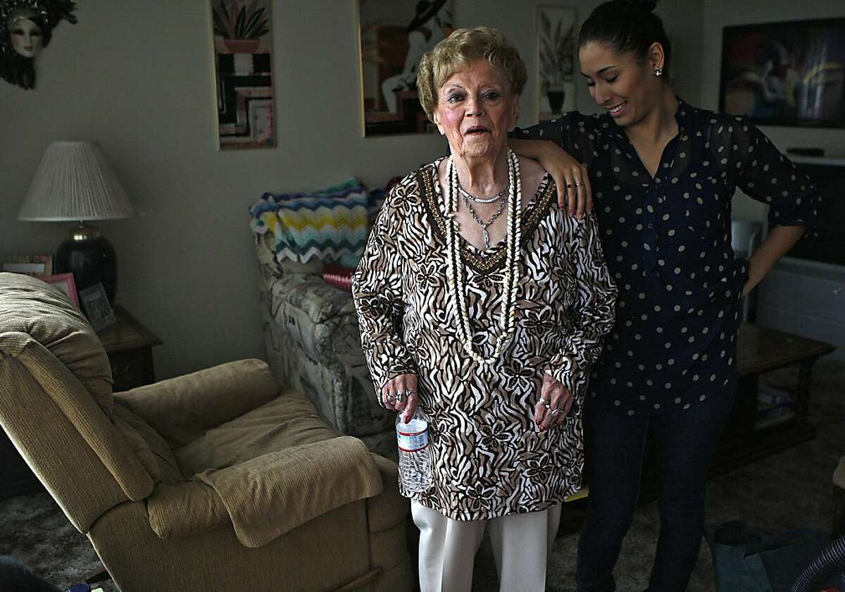 Betty Fereira (left), 81, with her roommate Martha Gama (right) in the living room at home in San Leandro, Calif., on Monday, November 19, 2012.