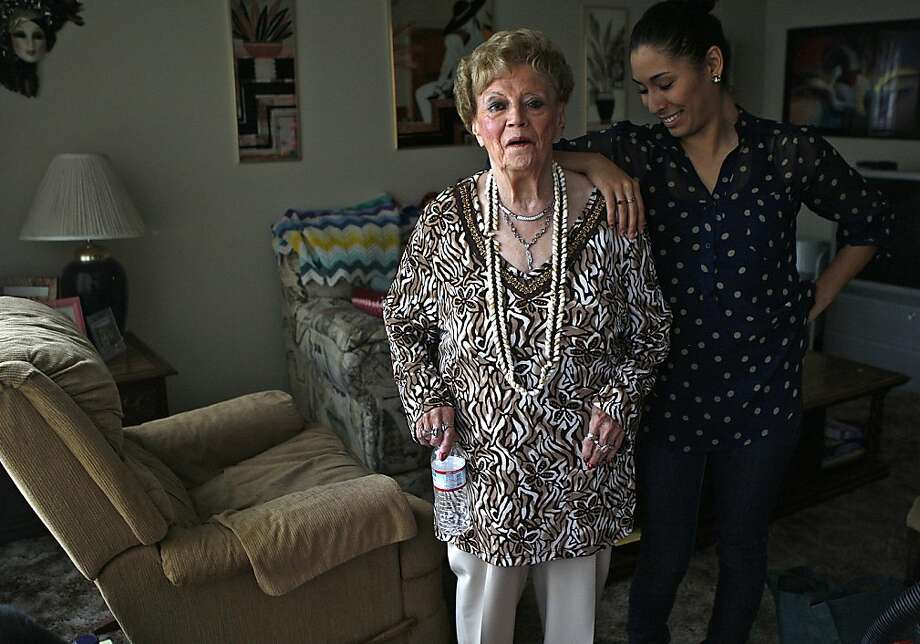 Betty Fereira, 81, with new roommate Martha Gama, 22 - who, like a gift, showed up one day with her 4-year-old daughter to share the rent and enliven Fereira's life - at Fereira's home in San Leandro. Photo: Liz Hafalia, The Chronicle