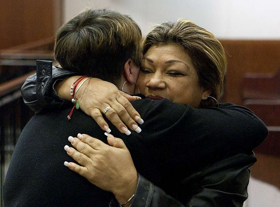 Tiffany Dickerson (left) hugs Rosie Castillo after the sentencing. Both women lost children in the fire at a Houston day care center for which Jessica Tata was sentenced to 80 years. Photo: Cody Duty, Associated Press