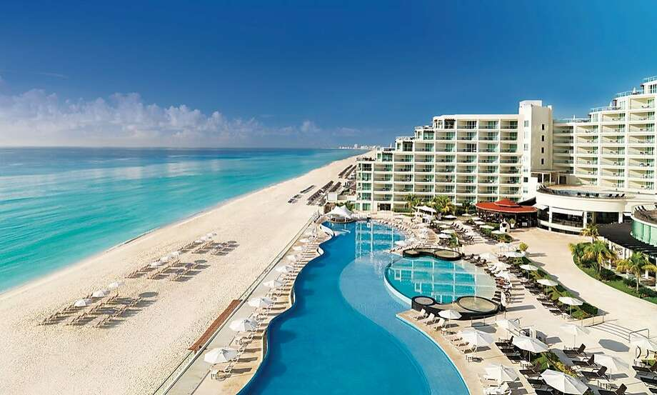 The Hard Rock Hotel Cancun has a sloping silhouette that vaguely calls to mind a Maya pyramid. Photo: Cancun  CVB