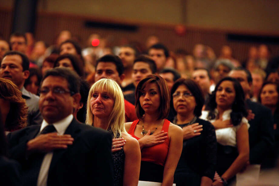 These are some of the 885 people who took the oath as citizens Tuesday. Photo: Lisa Krantz, San Antonio Express-News / © 2012 San Antonio Express-News