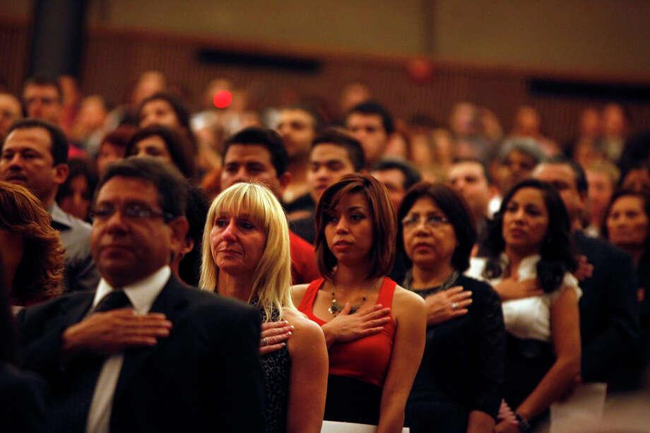 Ceremony ushers in 885 new citizens - San Antonio Express-News