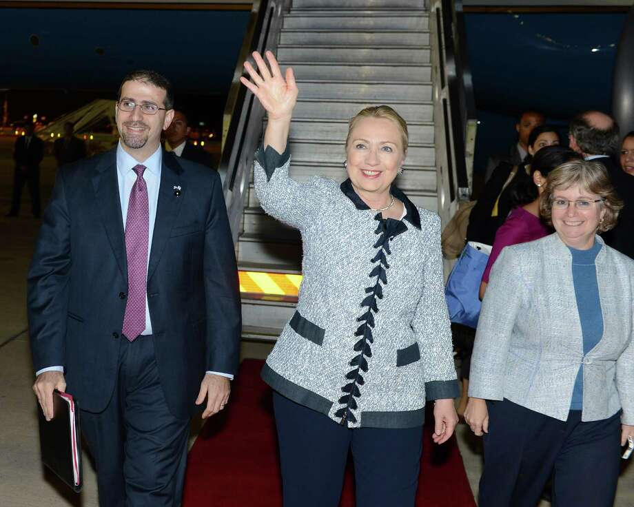 TEL AVIV, ISRAEL - NOVEMBER 18: In this handout provided by U.S. Embassy Tel Aviv, U.S. Secretary of State Hillary Clinton (C) arrives November 20, 2012 in Tel Aviv, Israel. Efforts by Western and Arab diplomats to end the confrontation between Israel and Gaza have escalated.  (Photo by Matty Stern/U.S. Embassy Tel Aviv via Getty Images) Photo: Handout / 2012 U.S. Embassy Tel Aviv