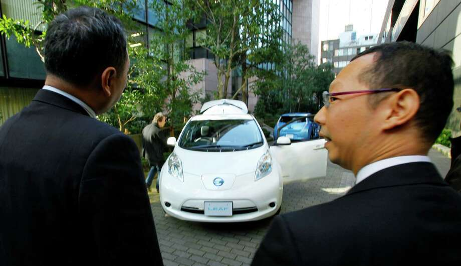 Nissan Motor Co.'s latest LEAF electric car is displayed for media in Tokyo, Tuesday, Nov. 20, 2012. The upgraded Leaf electric car from Nissan can travel further without recharging, comes in a cheaper model and tells drivers how much battery life is left. (AP Photo/Junji Kurokawa) Photo: Junji Kurokawa
