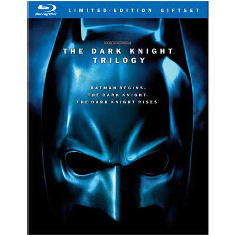 "DVDs — ""The Dark Knight Rises"" arrives Dec. 4, just in time to save the holidays for Batman fans. Indulge them with ""The Dark Knight Trilogy"" (Warner Bros., $52.99 on Blu-ray), which packages the entire Christopher Nolan-directed saga. Photo: Warner Bros. Home Entertainment"