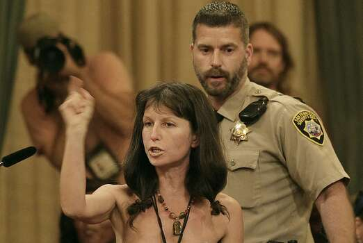 Protester Gypsy Taub speaks out against the Board of Supervisors decision to ban public nakedness while naked at City Hall in San Francisco, Tuesday, Nov. 20, 2012. San Francisco lawmakers on Tuesday narrowly approved a proposal to ban public nakedness, rejecting arguments that the measure would eat away at a reputation for tolerance enjoyed by a city known for flouting convention and flaunting its counter-culture image. The 6-5 Board of Supervisors vote means that exposed genitals will be prohibited in most public places, including streets, sidewalks and public transit. (AP Photo/Jeff Chiu) Photo: Jeff Chiu, Associated Press