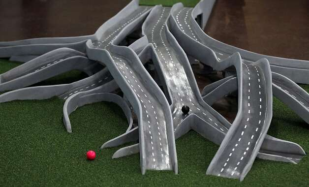 A miniature freeway interchange presents challenges to golfers at the Alameda mini-course, where Bay Area landmarks mark the holes. Photo: Lance Iversen, The Chronicle