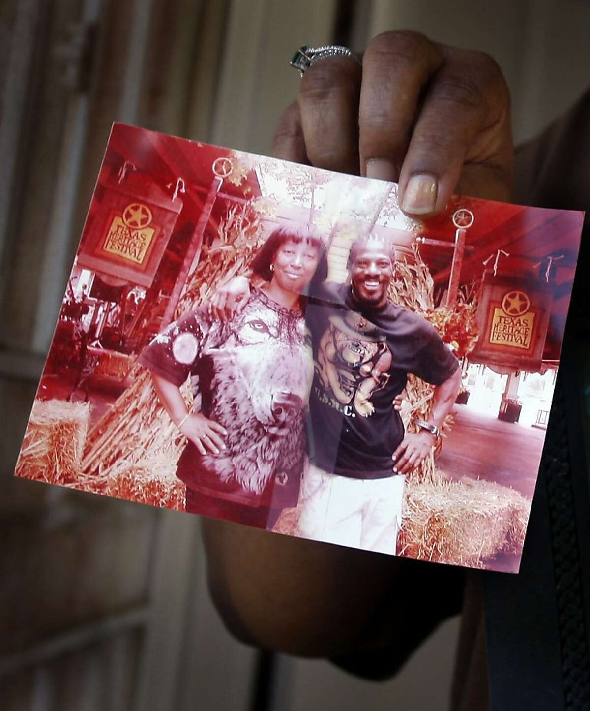Tyrice Ross holds a photo of her sister Deborah Ross and Nathaniel Burris at the home the couple shared in Richmond, Calif., on Wednesday, Aug. 12, 2009 on the morning after Burris reportedly killed Deborah Ross and her friend Ersie Charles Everette at the Richmond-San Rafael Bridge toll plaza. Authorities took Burris into custody early Wednesday morning in Placer County.