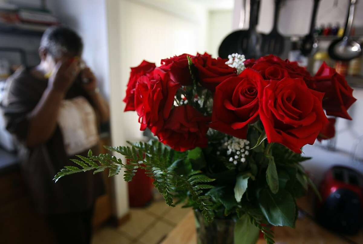 A bouquet of roses still sits on a kitchen counter at the home of Deborah Ross and Nathaniel Burris in Richmond. Burris, who reportedly killed Deborah and her friend Ersie Charles Everette at the Richmond-San Rafael Bridge toll plaza Tuesday evening, had given the flowers to Deborah on Monday after the couple had an argument.