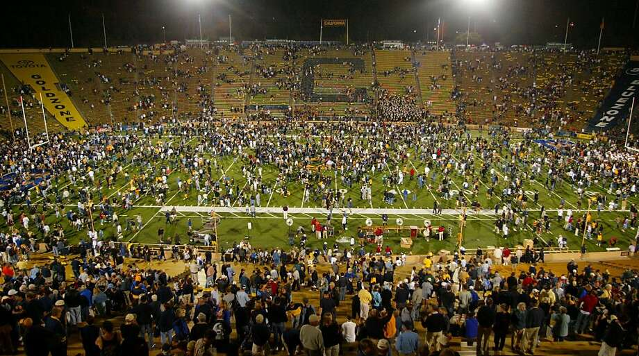 Cal fans swarm the field after the Bears' 34-31 defeat of USC in triple overtime at Memorial Stadium on Sept. 27, 2003. Photo: George Nikitin, AP