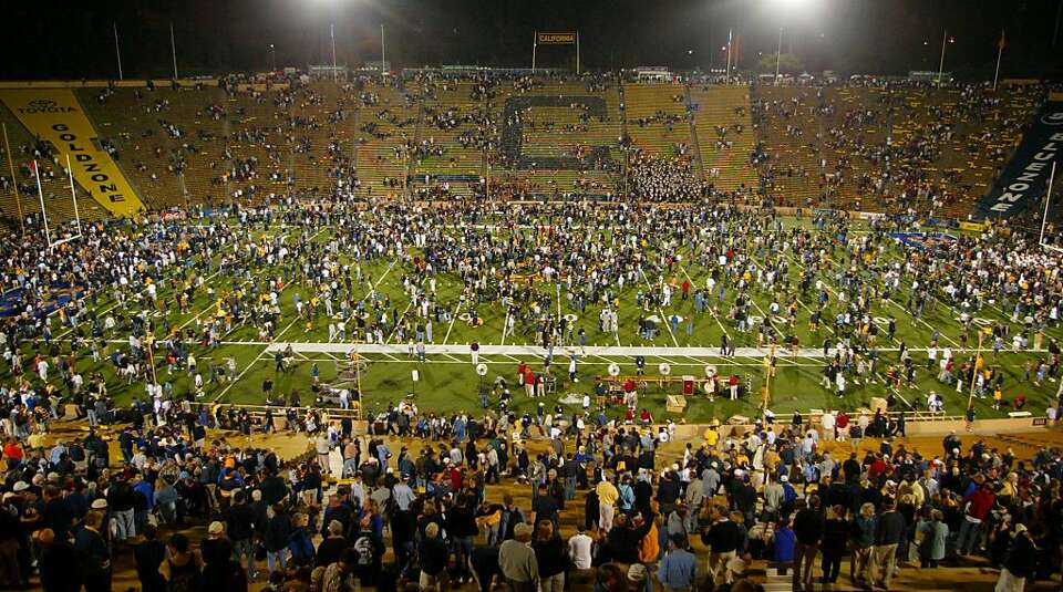 Cal fans swarm the field after the Bears' 34-31 defeat of USC in triple overtime at Memorial Stadium