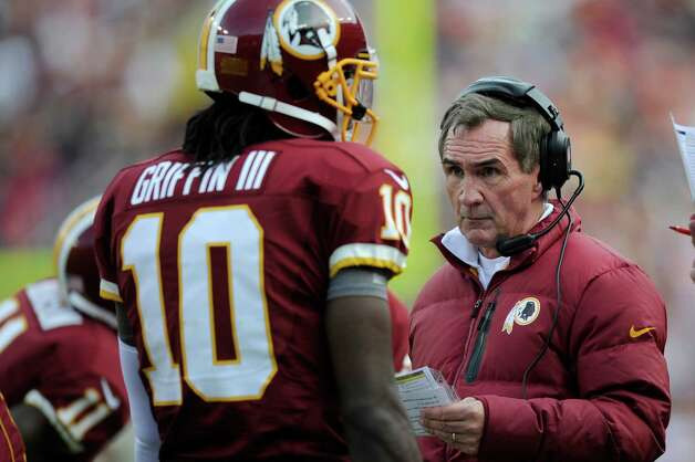 Washington Redskins head coach Mike Shanahan ranks with quarterback Robert Griffin III during the first half of an NFL football game against the Philadelphia Eagles in Landover, Md., Sunday, Nov. 18, 2012. (AP Photo/Nick Wass) Photo: Nick Wass, Associated Press / FR67404 AP