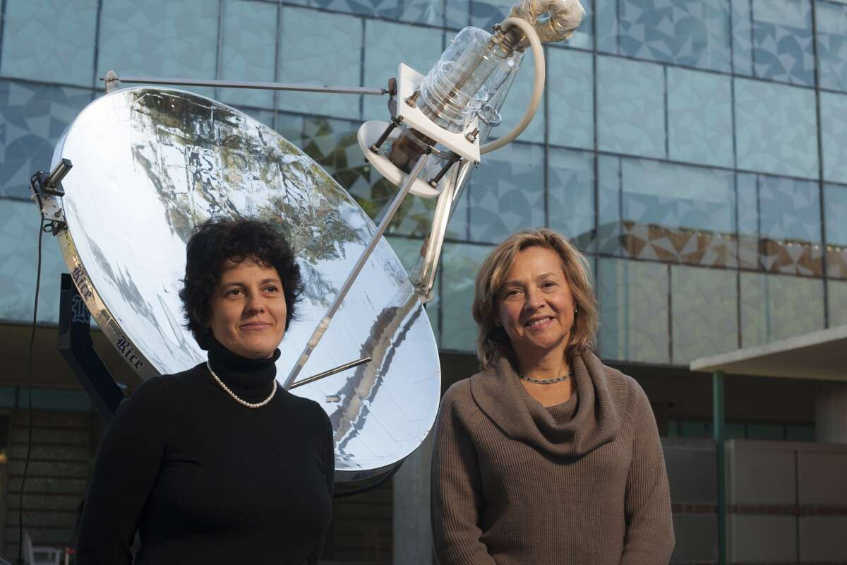 Rice University's Naomi Halas, right, created the cancer-fighting nanoshells in 1997. She is shown with graduate student Oara Neumann, left, in 2012 with a different experiment, using nanoparticles to create steam within seconds.