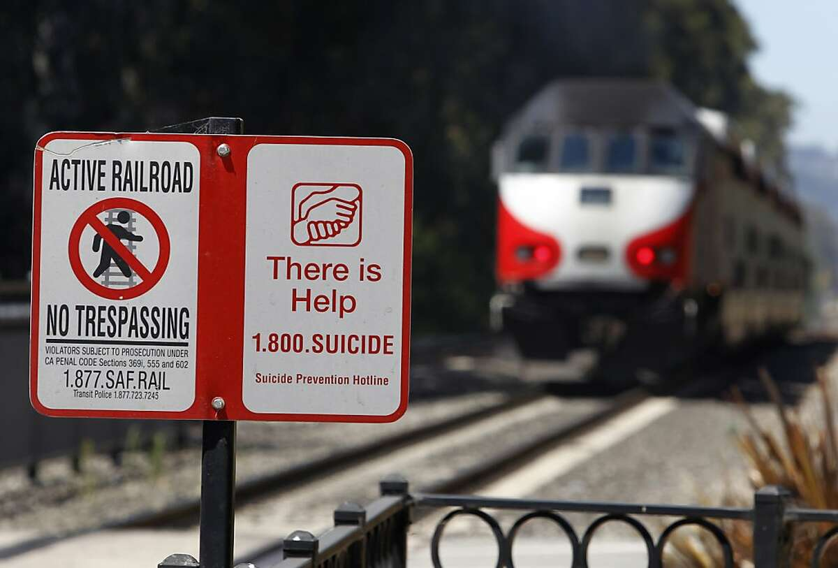 In this file photo, signs are posted to assist those contemplating end-of-life scenarios along the Caltrain system, including this one at the station in Burlingame. A northbound train going through Burlingame struck a trespasser on the tracks Monday morning, creating major delays.