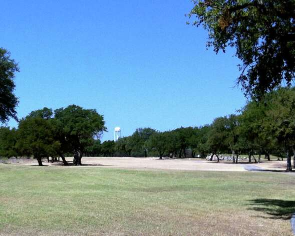 The Hawk at Rebecca Creek offers plenty of tree-lined fairways to challenge golfers to hit it straight off the tee. Photo: San Antonio Express-News