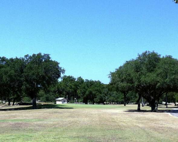 Trees guard the front of a green at The Hawk at Rebecca Creek. Photo: San Antonio Express-News