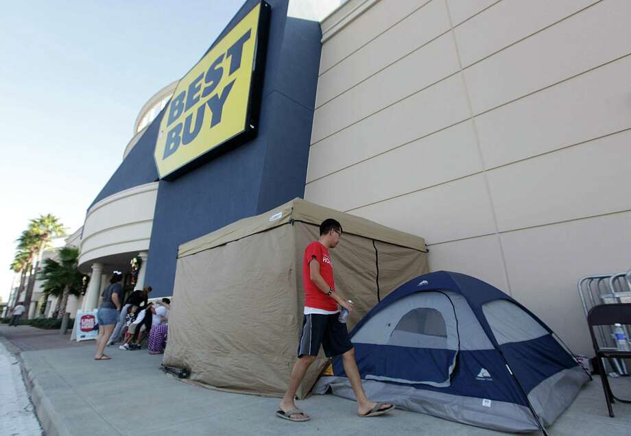 Kevin Huynh, 28, is sleeping outside the Meyerland's Best Buy to be second in line for the Black Friday sale on Tuesday, Nov. 20, 2012, in Houston.  Best Buy will allow shoppers to enter the store on Thursday at midnight.  ( Mayra Beltran / Houston Chronicle ) Photo: Mayra Beltran, Staff / © 2012 Houston Chronicle