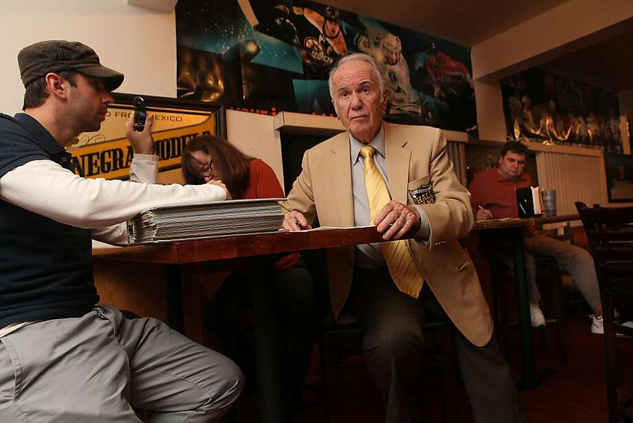 Andy Mousalimas makes mid-season draft picks with grandson Harry Ahlas in Oakland. Photo: Liz Hafalia, The Chronicle