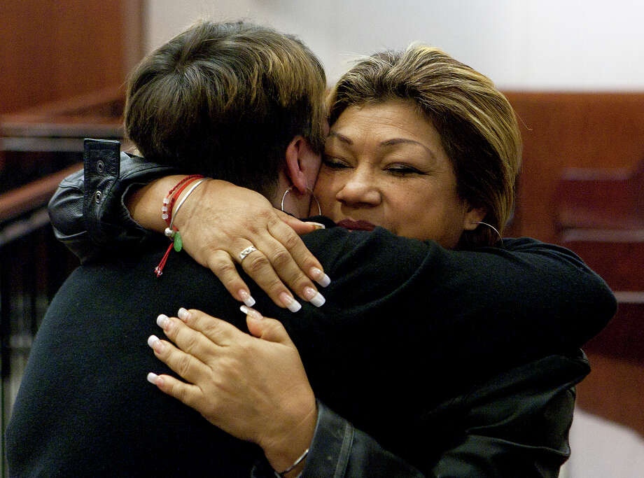 Tiffany Dickerson, left, hugs Rosie Castillo after Jessica Tata's sentencing Tuesday, Nov. 20, 2012, in Houston. Tata was sentenced to 80 years for her felony murder conviction of Elias Castillo, one of four children killed in a fire at her home day care in Houston. Dickerson also lost her son, three-year-old Shomari Dickerson, in the fire. Photo: Cody Duty, Houston Chronicle / © 2012 Houston Chronicle