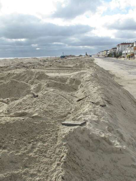 Piles of sand are all that remain where the Belmar N.J. boardwalk used to stand, in a Nov. 15, 2012 photo. Superstorm Sandy took a bite out of the Jersey shore, washing away millions of tons of sand and slimming down beaches along the state?s 127-mile coastline. (AP Photo/Wayne Parry) Photo: Wayne Parry, STF / AP
