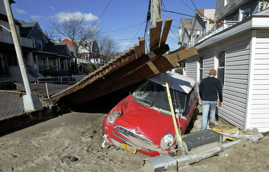 Many rental cars were swamped by Sandy, like the vehicle above, so it's tough to find a rental now. Photo: Kathy Willens, STF / AP