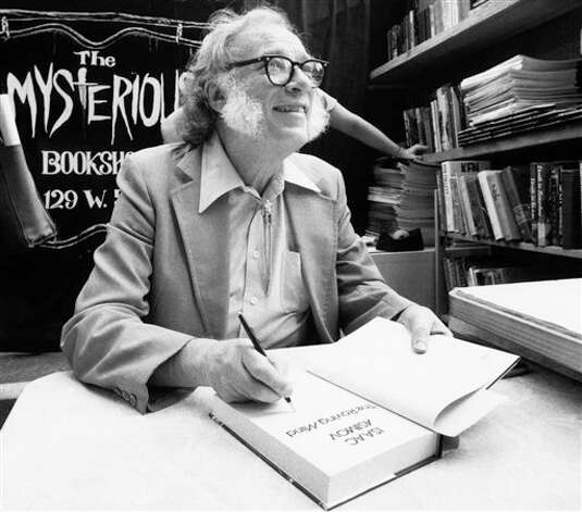 Author Isaac Asimov autographs books at the Mysterious Book Store stall on Feb. 2, 1984, during the Fifth Avenue Book Fair held in New York City. The science fiction writer contracted HIV from a blood transfusion received during a bypass operation and died in 1992. Photo: Mario Suriani, AP File Photo / AP1984