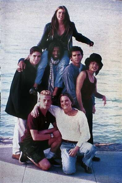 Pedro Zamora, standing at left, is shown with the rest of the cast of MTV's