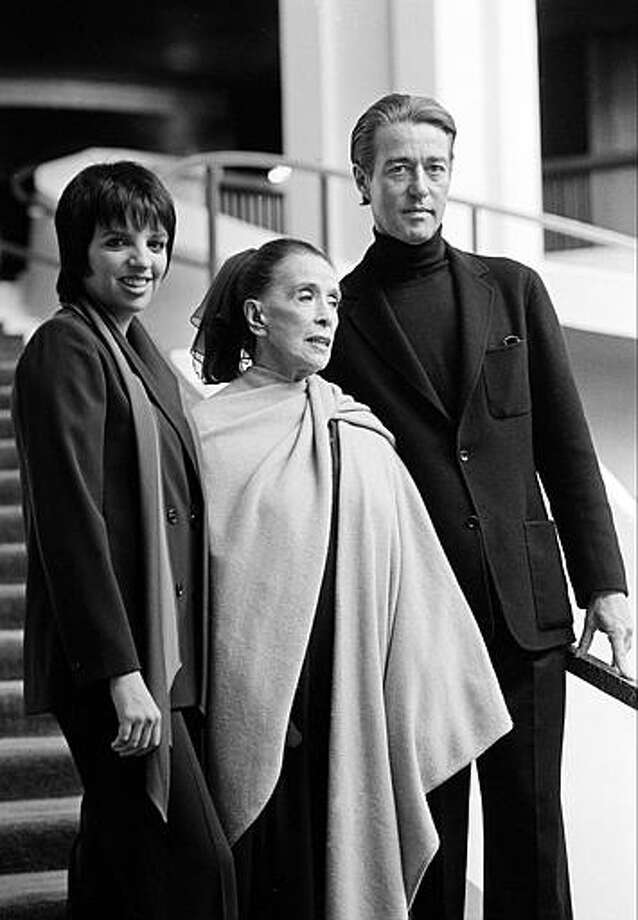 Choreographer Martha Graham, center, appears with singer-actress Liza Minnelli, left, and fashion designer Halston during a news conference at the Metropolitan Opera House at New York's Lincoln Center, Wednesday, Feb. 27, 1980. Halston died in 1990 from an AIDS-related cancer. Photo: AP File Photo / AP1980